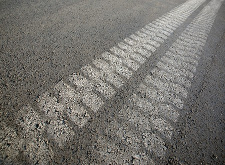 Tracks from a truck on black asphalt Stock Photo - 8172139