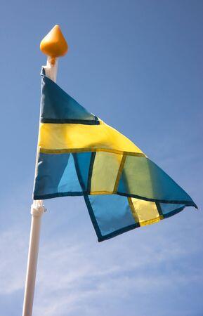Swedish flag against blue sky photo