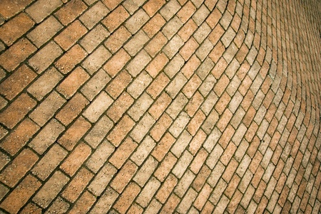 Diminishing perspective of bent red brick wall Stock Photo - 8305145