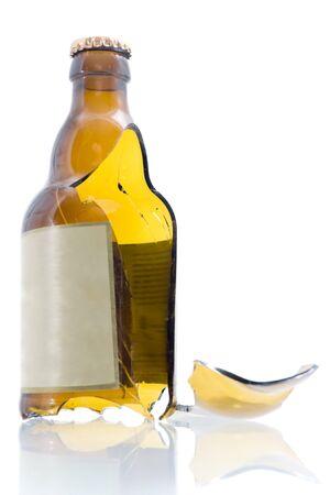 Broken beer bottle isolated on white photo