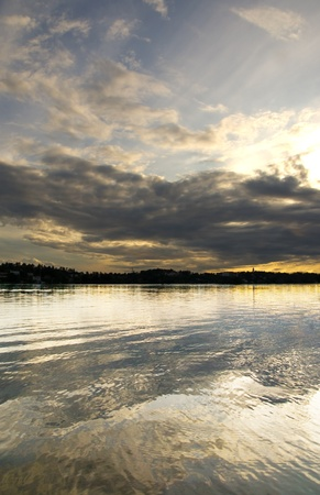 Beautiful sunset over a lake, with the cloudy sky reflected in the water Stock Photo - 8310494