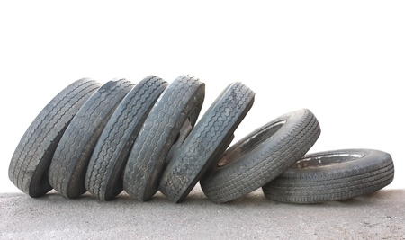 used: A row of old obsolete tires isolated on white