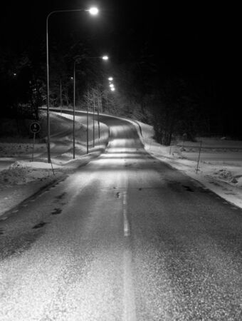 Empty winter road at night photo