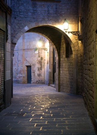Narrow street with archway in the Old Town of Barcelona, Spain. photo