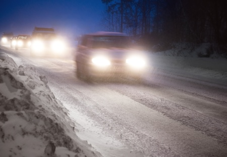 icy: Heavy traffic on a country road in a winter evening