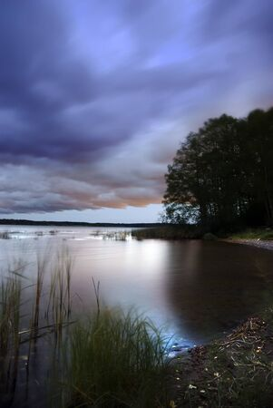 Tranquil scene of a small lake in the late evening Stock Photo - 8311595