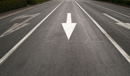 dividing lines: Arrow sign and dividing lines on highway