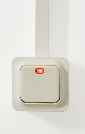 switch on the light: Interruptor de luz con una peque�a luz roja.