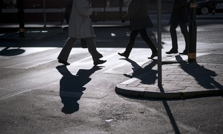 pedestrians: Silhouette of people at pedestrian crossing Stock Photo