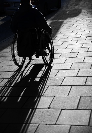 Silhouette of young man i wheelchair Stock Photo