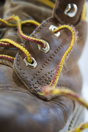 undone: Close up of leather boot with untied shoelace Stock Photo