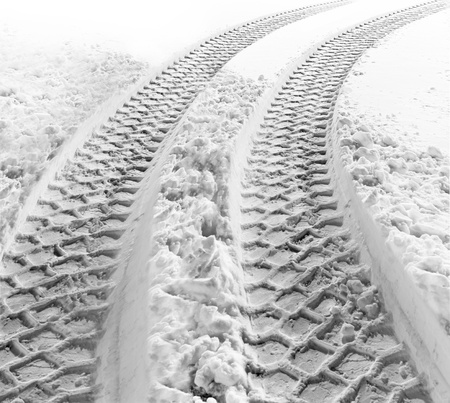 snow texture: Tracks of a heavy vehicle in white snow Stock Photo