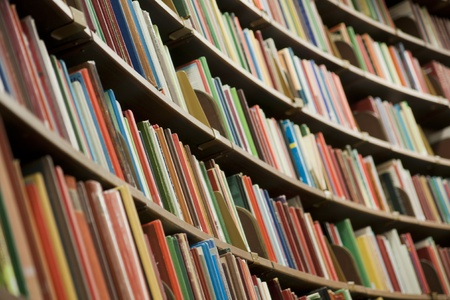Bookshelf in library with many books. Shallow dof. Stock Photo - 8869001