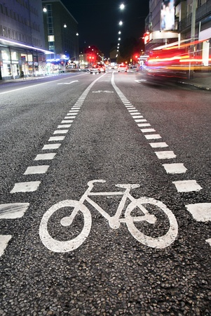 Bicycle symbol on city street in the evening photo