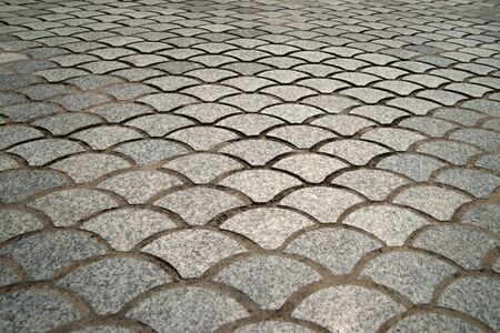 paving of street with interestingly shaped tiles photo