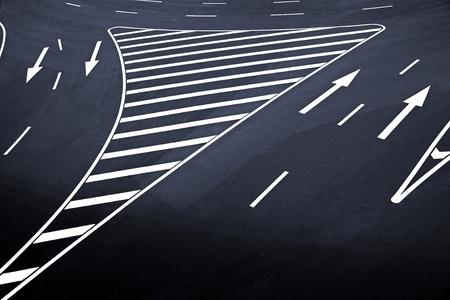 High angle view of arrow signs on  asphalt photo