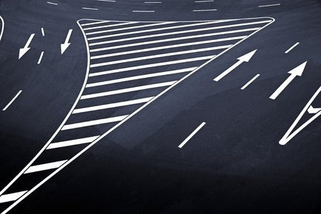 road marking: High angle view of arrow signs on  asphalt Stock Photo