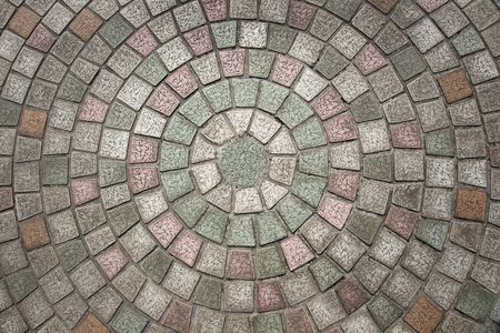 cobblestone pavement with circular pattern