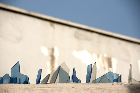 Broken glass on  top of a wall Stock Photo - 9197962