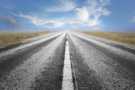 Long straight asphalt road and blue cloudy summer sky Stock Photo - 9238438