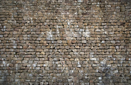 Background of wall built with natural rocks photo