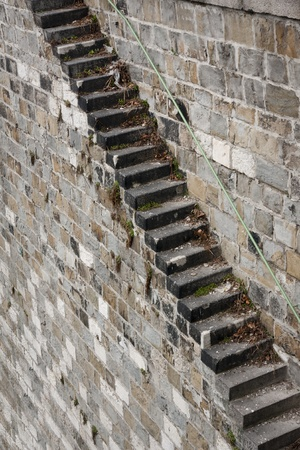 hand rail: long dangerous stone staircase with hand rail Stock Photo