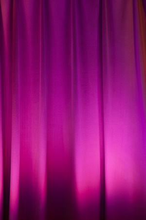 background of purple illuminated curtain photo