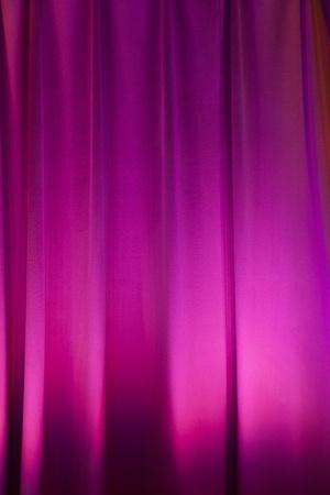 background of purple illuminated curtain