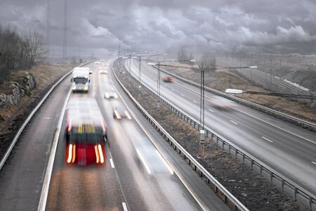 Traffic on highway on a foggy rainy day Stock Photo - 9441849