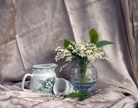 Still life with lily-of-the-valley flowers in a vase