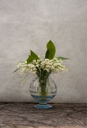 Still life with lily-of-the-valley flowers in a vase photo