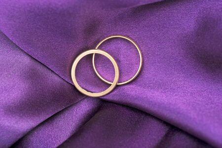 Two wedding rings on purple silk Stock Photo - 9658157
