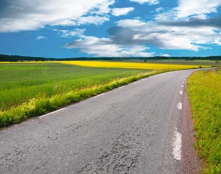 Asphalt road in a rural landscape Stock Photo - 9892665