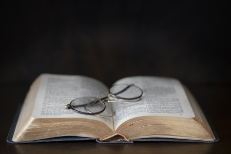 dark ages: Open vintage book with old fashioned glasses  Stock Photo
