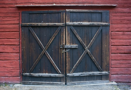 Old wooden door with padlock photo
