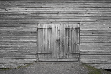 Dorr on old gray wooden barn photo