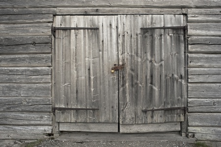 Old gray wooden door with padlock photo