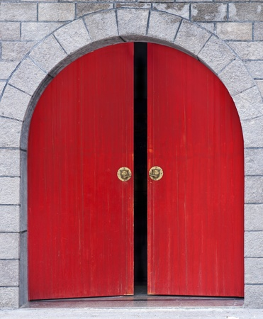 archway: Chinese red wooden door in stone wall