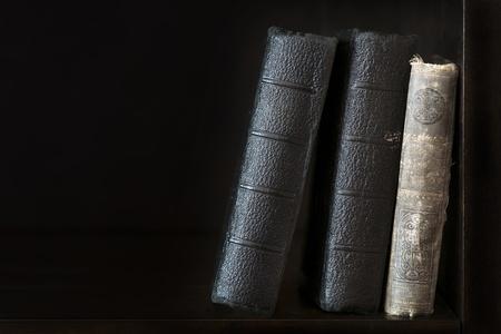 backs: backs of old books in bookshelf Stock Photo