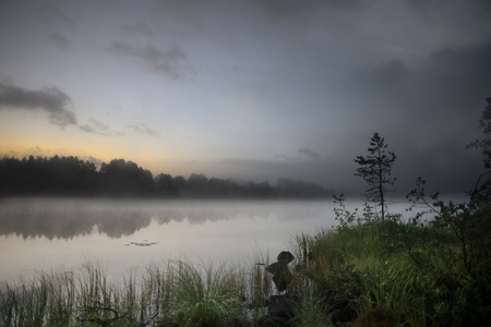 early summer: Foggy morning  at a lake in rural Sweden Stock Photo