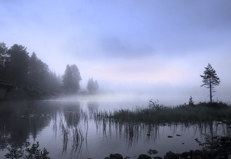 Fog over a Scandinavian lake photo
