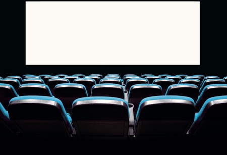 theaters: Backs of empty blue seats in a movie theater with a white screen