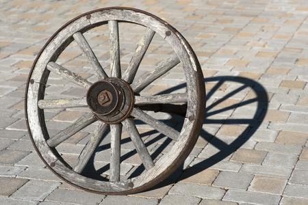 Old wagon wheel casting a shadow photo