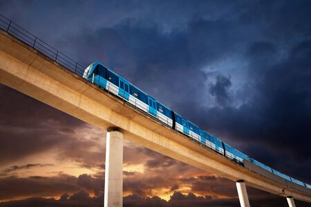 commuter train on elevated railway