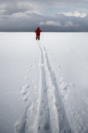 ski traces: Cross country skier in red dress