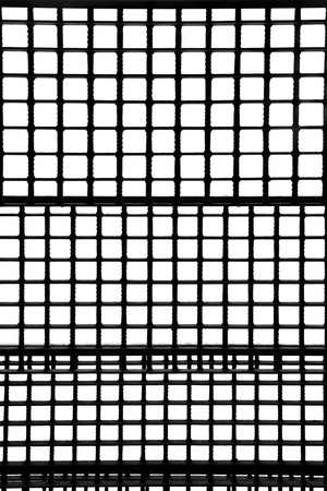 construction mesh: Metal staircase with bars seen from below on white background Stock Photo
