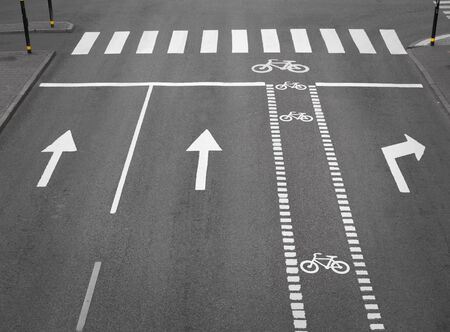 street with lanes, arrows and a cycliing path  photo