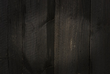 worn structure: Background of old black weathered wooden wall Stock Photo