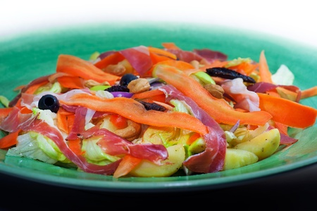 Ham sallad with carrot, black olives, dried tomatoes, potatoes, cashew nuts, ...