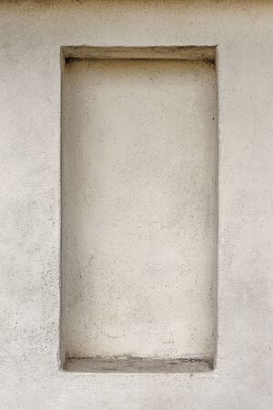 Empty frame with shelf in concrete wall. Copy space. photo